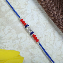 American Dianon with Blue Rakhi thread: Send Rakhi to London Boroughs